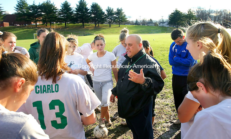 WATERBURY, CT. 17 November 2006--111706SV04--Head Coach Mike Mentone talks to his team during the Holy Cross girls soccer team's final practice before their state championship game this Saturday.<br /> Steven Valenti Republican-American