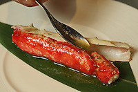 Steamed Alaskan King Crab with Lemon Scented Extra Virgin Olive Oil at Waku Ghin Restaurant at Marina Bay,  in Singapore 13 March 2015.