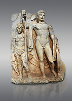 Roman Sebasteion relief  sculpture of emperor Tiberius with a captive Aphrodisias Museum, Aphrodisias, Turkey. <br /> <br /> The naked emperor Tiberius stands frontally holding a spear and shield wearing a cloak and a sword strap. Besides him stands a barbarian