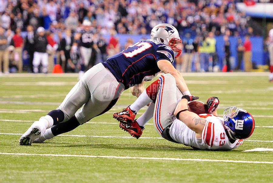 Feb 5, 2012; Indianapolis, IN, USA; New York Giants middle linebacker Chase Blackburn (93) intercepts a pass intended for New England Patriots tight end Rob Gronkowski (87) during the second half of Super Bowl XLVI at Lucas Oil Stadium.  Mandatory Credit: Mark J. Rebilas-