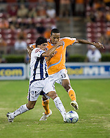 Pachuca FC midfielder Damian Alvarez (7) and  Houston Dynamo midfielder Ricardo Clark (13) battle for control of the ball.  Houston Dynamo defeated Pachuca FC 2-0 in the semifinals of the Superliga 2008 tournament at Robertson Stadium in Houston, TX on July 29, 2008.