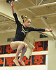 Jacklyn Dolitsky of Commack performs her routine on the balance beam during the Suffolk County varsity girls' gymnastics individual championships at Babylon High School on Friday, November 6, 2015.<br /> <br /> James Escher