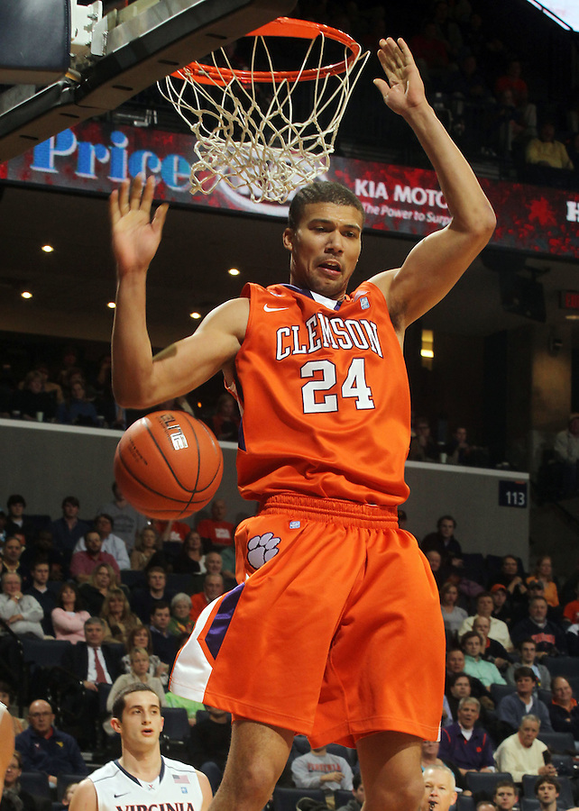 Feb. 2, 2011; Charlottesville, VA, USA; Clemson Tigers forward Milton Jennings (24) dunks the ball over Virginia Cavaliers guard Sammy Zeglinski (13) during the game at the John Paul Jones Arena. Mandatory Credit: Andrew Shurtleff