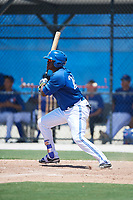 GCL Blue Jays right fielder Joseph Reyes (24) follows through on a swing during a game against the GCL Pirates on July 20, 2017 at Bobby Mattick Training Center at Englebert Complex in Dunedin, Florida.  GCL Pirates defeated the GCL Blue Jays 11-6 in eleven innings.  (Mike Janes/Four Seam Images)