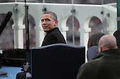 United States President Barack Obama sits during the presidential inauguration on the West Front of the U.S. Capitol January 21, 2013 in Washington, DC.   Barack Obama was re-elected for a second term as President of the United States.  .Credit: Win McNamee / Pool via CNP