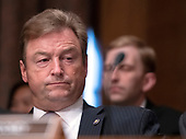 United States Senator Dean Heller (Republican of Nevada) listens as Kathleen Laura Kraninger testifies on her nomination to be Director, Bureau of Consumer Financial Protection (CFPB), and Kimberly A. Reed testifies on her nomination to be President, Export-Import Bank, before the US Senate Committee on Banking, Housing and Urban Affairs on Capitol Hill in Washington, DC on Thursday, July 19, 2018.<br /> Credit: Ron Sachs / CNP