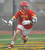 Patrick Kavanagh #4 of Chaminade circles behind the net during a non-league varsity boys lacrosse game against host Massapequa High School on Wednesday, April 4, 2018. Chaminade won by a score of 8-5.