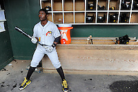 Infielder Dilson Herrera (31) of the West Virginia Power waits in the dugout for the start of a game against the Greenville Drive on Monday, April 15, 2013, at Fluor Field at the West End in Greenville, South Carolina. Herrera is the No. 20 prospect of the Pittsburgh Pirates, according to Baseball America. West Virginia won, 6-0. (Tom Priddy/Four Seam Images)