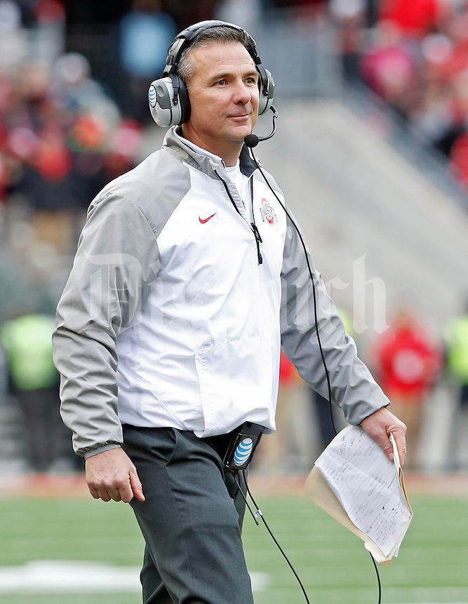 Ohio State Buckeyes head coach Urban Meyer smiles after Ohio State Buckeyes scores a touchdown in the 4th quarter of their game at Ohio Stadium in Columbus, Ohio on November 29, 2014.  (Dispatch photo by Kyle Robertson)