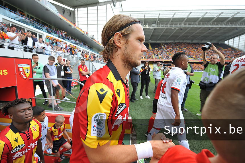 20190803 - LENS , FRANCE : illustration picture shows Lens' player Guillaume Gillet entering the pitch pictured during the soccer match between Racing Club de LENS and En Avant Guingamp , on the second matchday in the French Dominos pizza Ligue 2 at the Stade Bollaert Delelis stadium , Lens . Saturday 3 th August 2019 . PHOTO DIRK VUYLSTEKE | SPORTPIX.BE