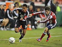 D.C. United defender Andy Najar (14) goes against Chivas USA defender Jorge Villafana (19) D.C. United defeated Chivas USA 1-0 at RFK Stadium, Sunday September 23, 2012.