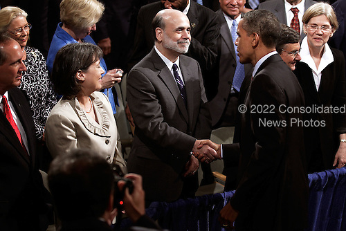 "United States President Barack Obama shakes hands with Federal Reserve Bank Chairman Ben Bernanke (C) as FDIC Chair Sheila Bair (2nd L) looks on after Obama signed the the financial reform bill into law during a ceremony at the Ronald Reagan Building and International Trade Center, Wednesday, July 21, 2010 in Washington, DC. A sweeping expansion of federal financial regulation in the wake of the worst recession since the Great Depression, the bill will create a consumer protection agency, lay out a blueprint for disassembling financial entities considered ""too big to fail,"" and many other  reforms.  .Credit: Chip Somodevilla - Pool via CNP"