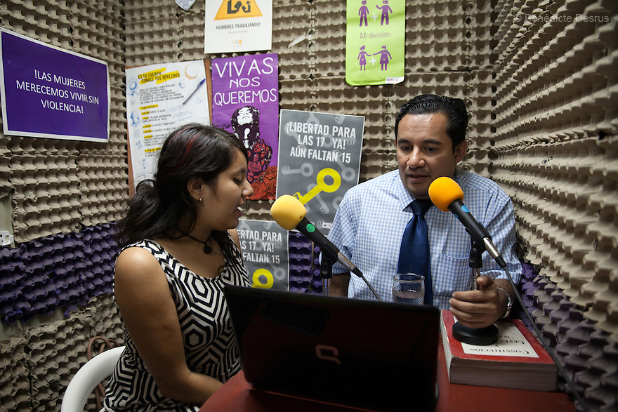 """Sara García Gross (L) and Dennis Estanley Muñoz Rosa (R), a lawyer working with rights groups to free women in prison on abortion charges, talk during a radio program called """"From the hospital to the prison"""" at """"La Casa de Todas"""" in San Salvador, El Salvador on June 10, 2015. Abortion in El Salvadorisillegal. The law formerly permitted an abortion to be performed under some limited circumstances, but, in 1998, all exceptions were removed when a newabortion law went into effect. Photo by Bénédicte Desrus"""