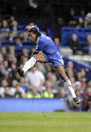 30 April 2008: Chelsea striker Didier Drogba shoots during the UEFA Champions League semi-final, 2nd leg between Chelsea and Liverpool played at Stamford Bridge. Chelsea won the game 3-2 after extra time, 4-3 on aggregate. Photo: Actionplus....080430 soccer football player shooting shot