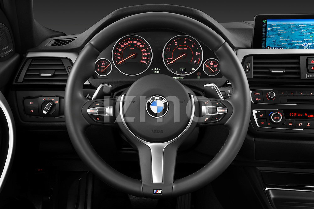 Steering wheel view of a 2013 BMW 330d Touring Wagon