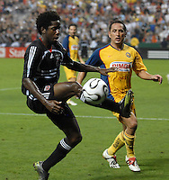DC United midfielder Clyde Simms (19) tries to gain control of the ball. DC United defeated Club America 1-0 to secure one of the two semifinal berths in SuperLiga group B, at RFK Stadium in Washington DC, Sunday July 29, 2007.