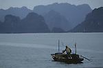Solo rowboat on Halong Bay