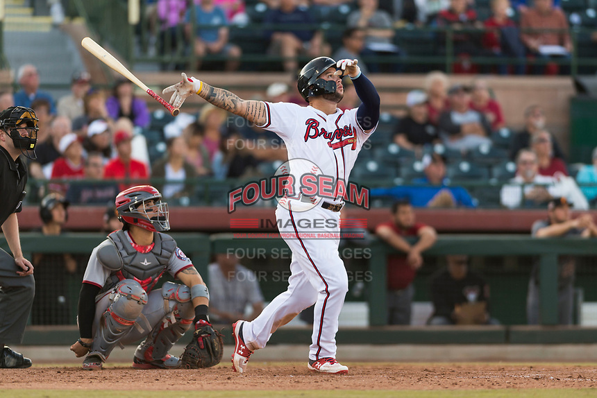 Peoria Javelinas first baseman Braxton Davidson (34), of the Atlanta Braves organization, hits a walk-off home run in front of catcher Tres Barrera (12) and home plate umpire John Bacon to win the Arizona Fall League Championship Game against the Salt River Rafters at Scottsdale Stadium on November 17, 2018 in Scottsdale, Arizona. Peoria defeated Salt River 3-2 in 10 innings. (Zachary Lucy/Four Seam Images)