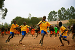 The opposing team celebrates their winning goal during a soccer game at Hamomi Children's Centre in Nairobi, Kenya