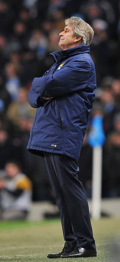 A dejected Manchester City's Manager Manuel Pellegrini<br /> <br /> Photographer Dave Howarth/CameraSport<br /> <br /> Football - Barclays Premiership - Manchester City v Arsenal - Sunday 18th January 2015 - Etihad stadium - Manchester<br /> <br /> &copy; CameraSport - 43 Linden Ave. Countesthorpe. Leicester. England. LE8 5PG - Tel: +44 (0) 116 277 4147 - admin@camerasport.com - www.camerasport.com