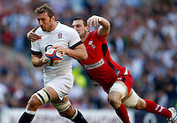 Photo: Richard Lane/Richard Lane Photography. England v Wales. RBS Six Nations. 09/03/2014. England's Chris Robshaw is tackled by Wales' Sam Warburton