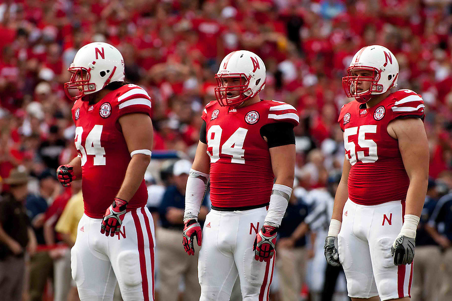 03 Sep 2011: Cameron Meredith #34, Jared Crick #94, and Baker Steinkuhler #55 of the Nebraska Cornhuskers waiting to lineup against the Chattanooga Mocs at Memorial Stadium in Lincoln, Nebraska. Nebraska defeated Chattanooga 40 to 7.