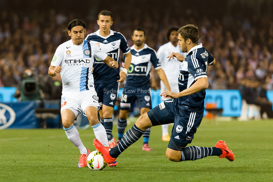David Williams of City is tackled by Mathieu Delpierre of the Victory in the semi final match between Melbourne Victory and Melbourne City in the Australian Hyundai A-League 2015 season at Etihad Stadium, Melbourne, Australia.<br />