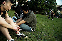 Duwei, drummer for the Nanjing-based punk band Overdose, rests in a park with friends before a gig at the small YuYinTang rock club in Shanghai, China.