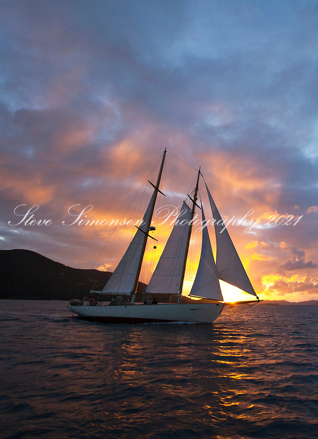 Sailing vessel Heron at sunset from Francis Bay, St. John