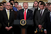 United States President Donald J. Trump participates in a photo opportunity with the 2018 Division I FCS National Champions: The North Dakota State Bison in the State Dining Room of the White House on March 4, 2019 in Washington, DC.<br /> Credit: Oliver Contreras / Pool via CNP