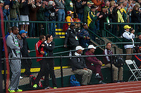 With the crowd cheering, University of Oregon assistant track coach Maurica Powell skips down the coaches box in celebration, pulling up next to head coach Robert Johnson as senior Laura Roesler pulls away from the field on her way to victory in the 800-meter run at the 2014 NCAA Division I Outdoor Track and Field Championships in Eugene, Oregon, Friday, June 13.