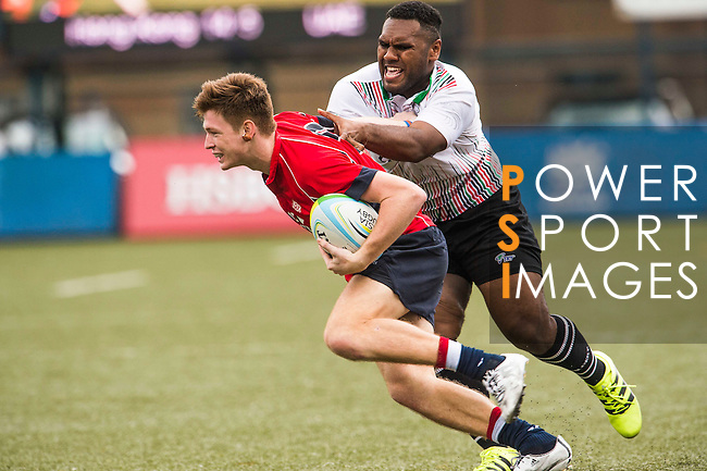 Liam Herbert (l) of Hong Kong battles for the ball during the match between Hong Kong and United Arab Emirates of the Asia Rugby U20 Sevens Series 2016 on 12 August 2016 at the King's Park, in Hong Kong, China. Photo by Marcio Machado / Power Sport Images