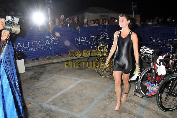 HEATHER TOM.23rd Annual Nautica Malibu Triathalon held at Zuma Beach, Malibu, California, USA..September 13th, 2009.full length black spandex sport shorts top .CAP/ADM/BP.©Byron Purvis/AdMedia/Capital Pictures.