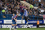 Crystal Palace defender Clint Hill wins a header against Sheffield Wednesday's Jermaine Johnson (right) at Hillsborough during the crucial last-day relegation match. The match ended in a 2-2 draw which meant Wednesday were relegated to League 1. Crystal Palace remained in the Championship despite having been deducted 10 points for entering administration during the season.