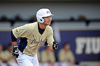 4 March 2012:  FIU infielder/outfielder Tyler James Shantz (5) watches his hit sail over the fence for a solo home run early in the game as the FIU Golden Panthers defeated the Brown University Bears, 8-3, at University Park Stadium in Miami, Florida.