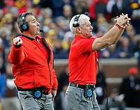 Ohio State Buckeyes head coach Urban Meyer and assistant coach Kerry Coombs call plays against Michigan Wolverines during the 1st half of their game at Michigan Stadium on November 25, 2017.  [Kyle Robertson\ Dispatch]