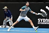 11th January 2018, Sydney Olympic Park Tennis Centre, Sydney, Australia; Sydney International Tennis,quarter final; Adrian Mannarino (ITA) stretches to hit a forehand return in his match against Fabio Fognini (ITA)