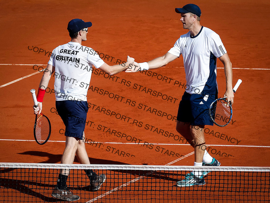 BELGRADE, SERBIA - JULY 16: Jamie Murray (L) and Dominic Inglot (R) of Great Britain celebrate a point in the doubles match against  Nenad Zimonjic and Filip Krajinovic during day two of the Davis Cup Quarter Final match between Serbia and Great Britain on Stadium Tasmajdan on July 16, 2016 in Belgrade, Serbia. (Photo by Srdjan Stevanovic/Getty Images)