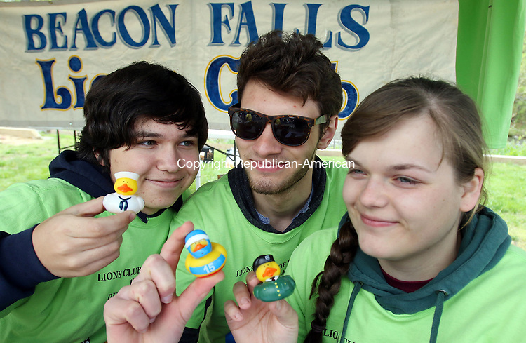 BEACON FALLS CT. 07 May 2017-050717SV06-From left, Michael Baz, 16, Austin Woloszyn, 14, and Natalie Katrenya, 16, all of Beacon Falls sell little ducks at the 19th annual Duck Race and Riverfest in Beacon Falls Sunday.  The three are members of the Leo&rsquo;s Club a youth group with the Beacon Falls Lions Club.<br /> Steven Valenti Republican-American
