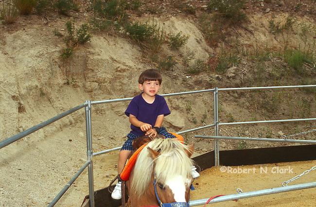 Boy riding pony