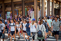 Hordes of shoppers cross Spring Street at Broadway. in Soho in New York on Saturday, June 24, 2017. (© Richard B. Levine)