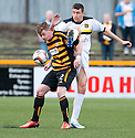 Alloa's Michael Doyle holds off Dumbarton's Colin Nish.
