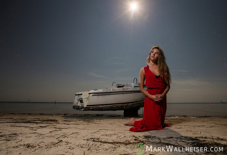 Anna Kate Pomeroy under the full moon at Shell Point Beach along the Forgotten Coast of the Florida panhandle.