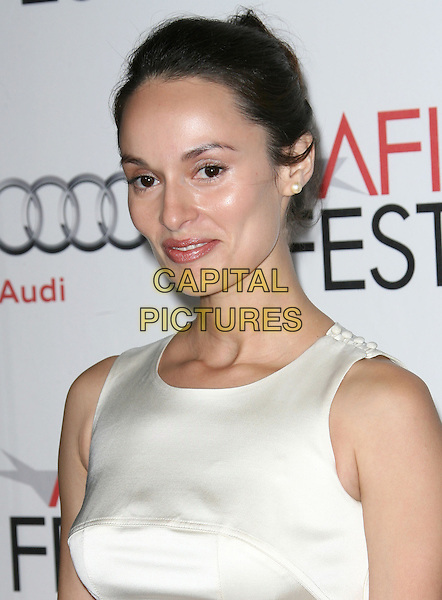 "BERENICE NORIEGA .attending the AFI Fest 2010 Centerpiece Gala Screening of ""Abel"" held at The Grauman's Chinese Theatre, Hollywood, California, USA, November 7th, 2010..portrait headshot white sleeveless hair up .CAP/RKE/DVS.©DVS/RockinExposures/Capital Pictures."