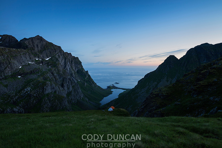 Twilight view of mountain camp over hidden valley, Moskenesøy, Lofoten Islands, Norway