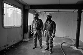 Workers prepare to remove asbestos from a flat in Chantry Point, before demolition of the twenty storey block on Elgin Estate in North Paddington, London.  The building had previously been used by Westminster City Council to house homeless families, a spin-off from it's illegal 'Designated Sales' policy.