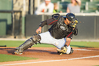 Kannapolis Intimidators catcher Omar Narvaez (10) can't handle a throw at home plate during the game against the Hickory Crawdads at CMC-Northeast Stadium on May 2, 2014 in Kannapolis, North Carolina.  The Crawdads defeated the Intimidators 7-2.  (Brian Westerholt/Four Seam Images)