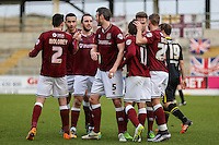 John-Joe O'Toole of Northampton Town (3rd left) celebrates scoring his team's second goal against Morecambe to make it 2-0 during the Sky Bet League 2 match between Northampton Town and Morecambe at Sixfields Stadium, Northampton, England on 23 January 2016. Photo by David Horn / PRiME Media Images.