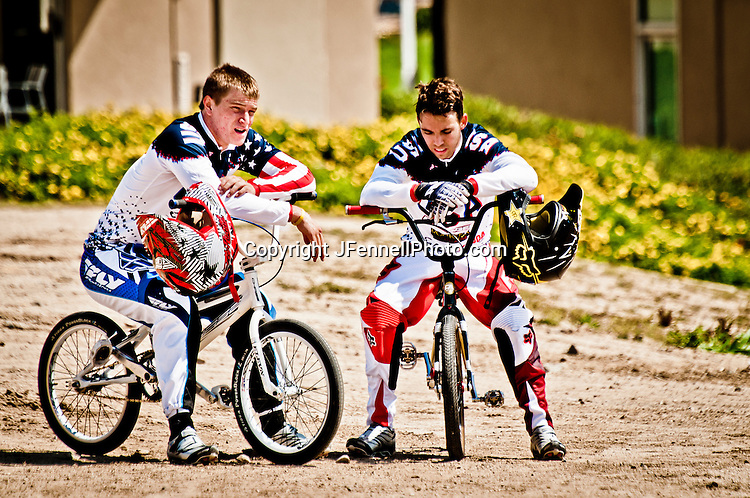 Connor Fields talking with a team mate during BMX practice session, on the London Replica BMX track at the US Olympic Training Center in Chula Vista, CA