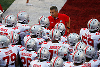 Ohio State Buckeyes head coach Urban Meyer huddles with his team prior to the NCAA football game against Indiana University at Memorial Stadium in Bloomington, Ind. on Aug. 31, 2017. [Adam Cairns/Dispatch]